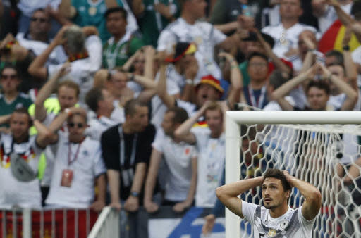 Germany's Mats Hummels reacts along with Germany fans after Germany's loss to Mexico in their group F match at the 2018 soccer World Cup in the Luzhniki Stadium in Moscow, Russia, Sunday, June 17, 2018. (AP Photo/Eduardo Verdugo)