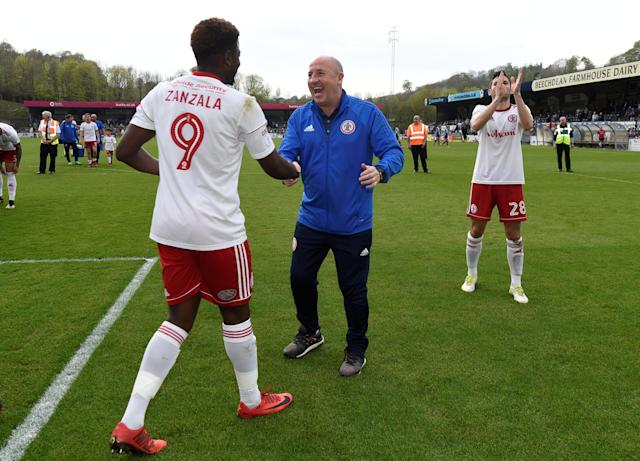 "Soccer Football - League Two - Wycombe Wanderers v Accrington Stanley - Adams Park, Wycombe, Britain - April 21, 2018 Accrington Stanley manager John Cole and Offrande Zanzala celebrate after the match Action Images/Tony O'Brien EDITORIAL USE ONLY. No use with unauthorized audio, video, data, fixture lists, club/league logos or ""live"" services. Online in-match use limited to 75 images, no video emulation. No use in betting, games or single club/league/player publications. Please contact your account representative for further details."