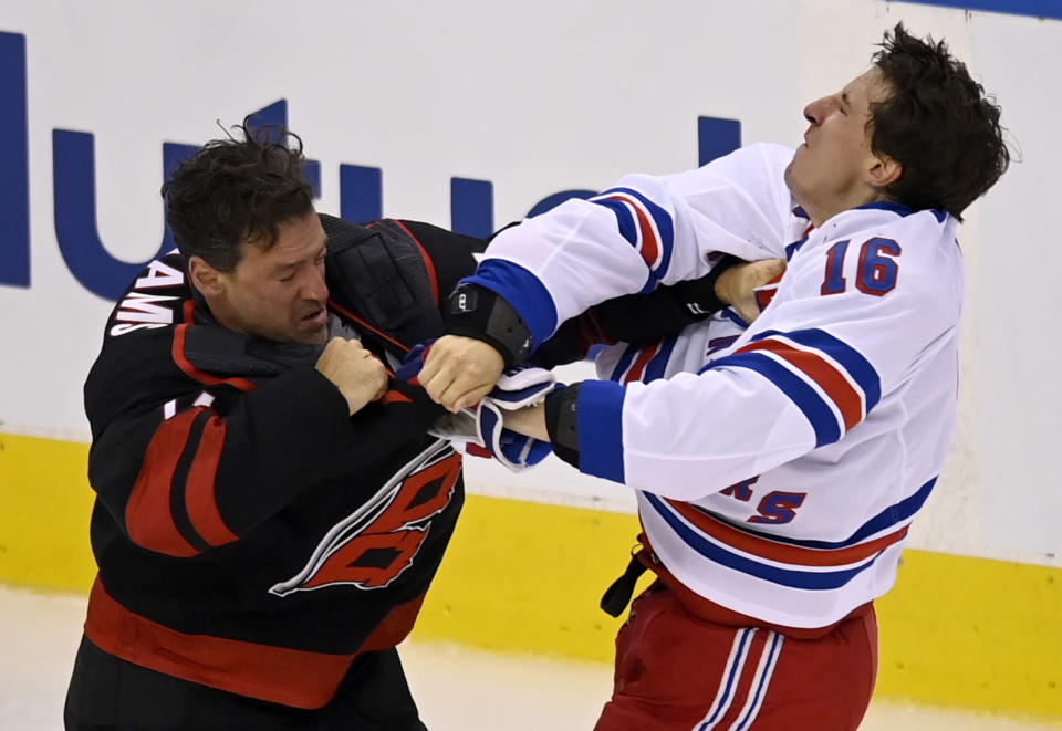 New York Rangers' Ryan Strome (16) fights with Carolina Hurricanes' Justin Williams during the first period in the NHL hockey Stanley Cup playoffs in Toronto, Saturday, Aug. 1, 2020. (Frank Gunn/The Canadian Press via AP)