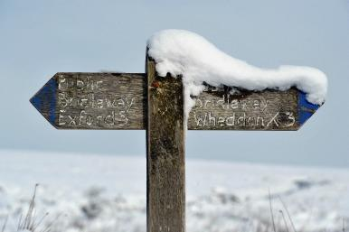 snow-covered sign