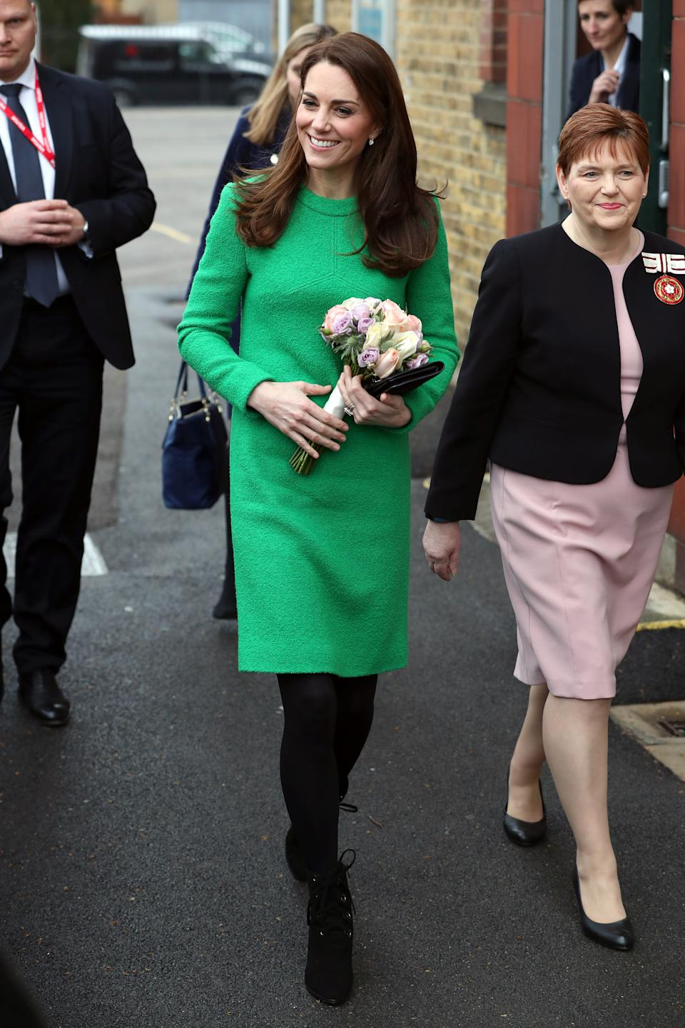 The Duchess of Cambridge visited Lavender Primary School in February wearing a bright green shift dress by Eponine London [Photo: Getty Images]