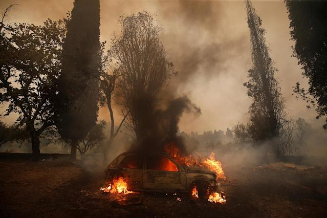 <p>A car burns during a forest fire in the village of Carvoeiro, near Castelo Branco, Portugal, July 25, 2017. (Rafael Marchante/Reuters) </p>
