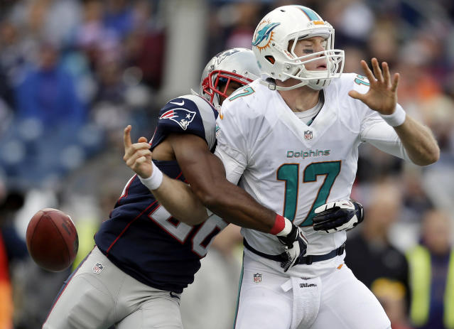 New England Patriots defensive back Logan Ryan, left, strips the ball from Miami Dolphins quarterback Ryan Tannehill (17) in the second half of an NFL football game on Sunday, Oct. 27, 2013, in Foxborough, Mass. (AP Photo/Steven Senne)