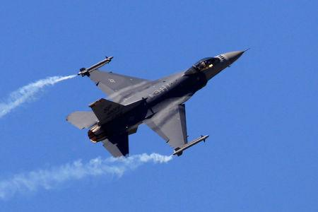 FILE PHOTO: A F-16 Fighting Falcon fighter jet takes part in a flying display during the 49th Paris Air Show
