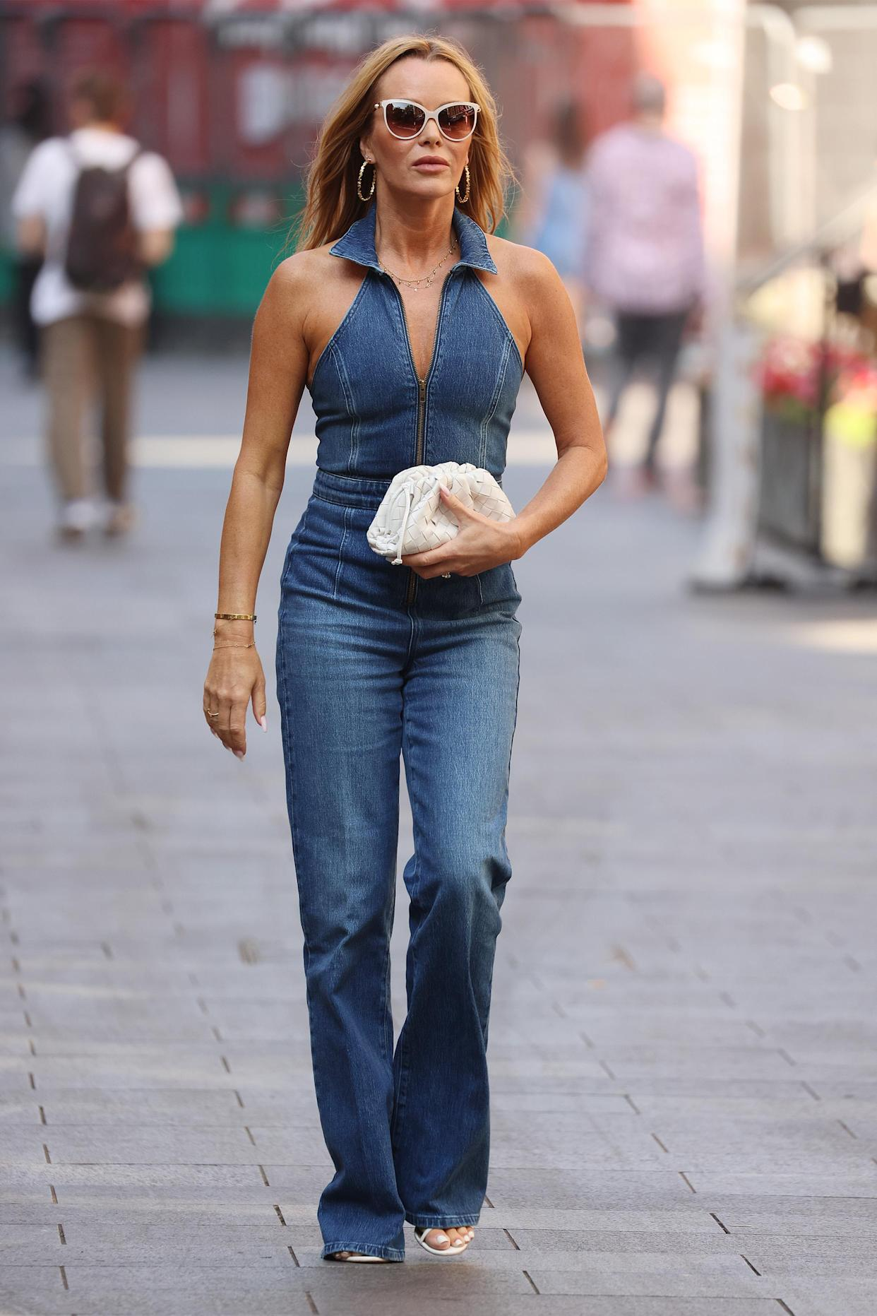 Amanda Holden wears 70s inspired Pennie Halterneck Jumpsuit from Reiss to co-host Heart Breakfast Radio. (Getty Images)