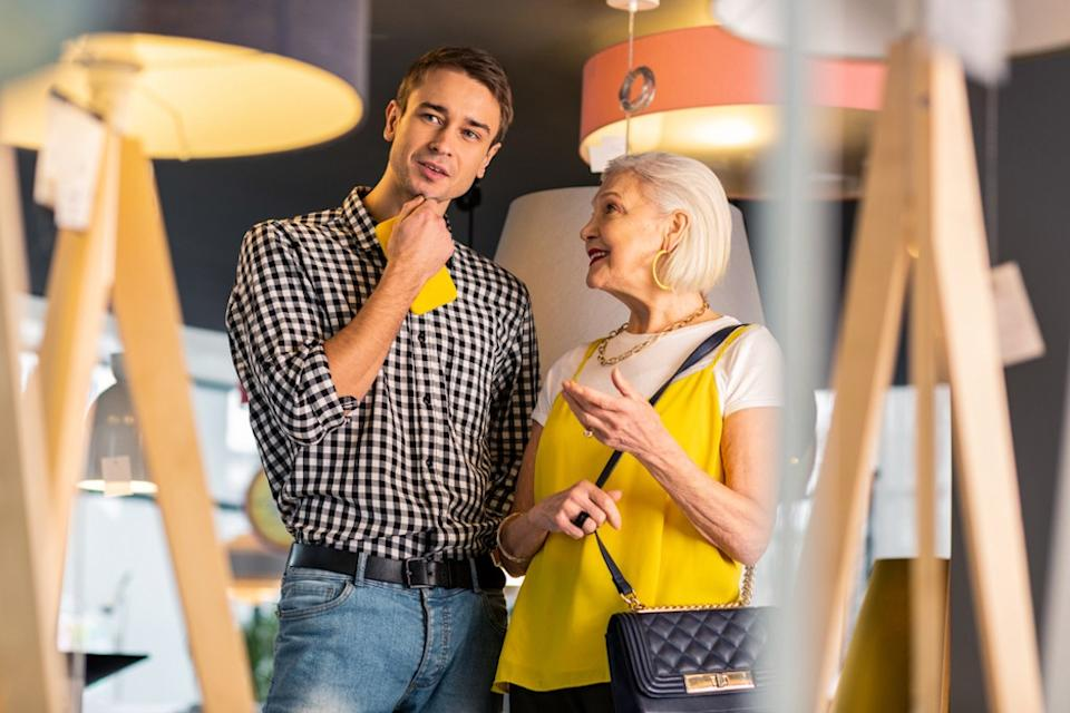 older woman smiling at younger man, downsizing your home