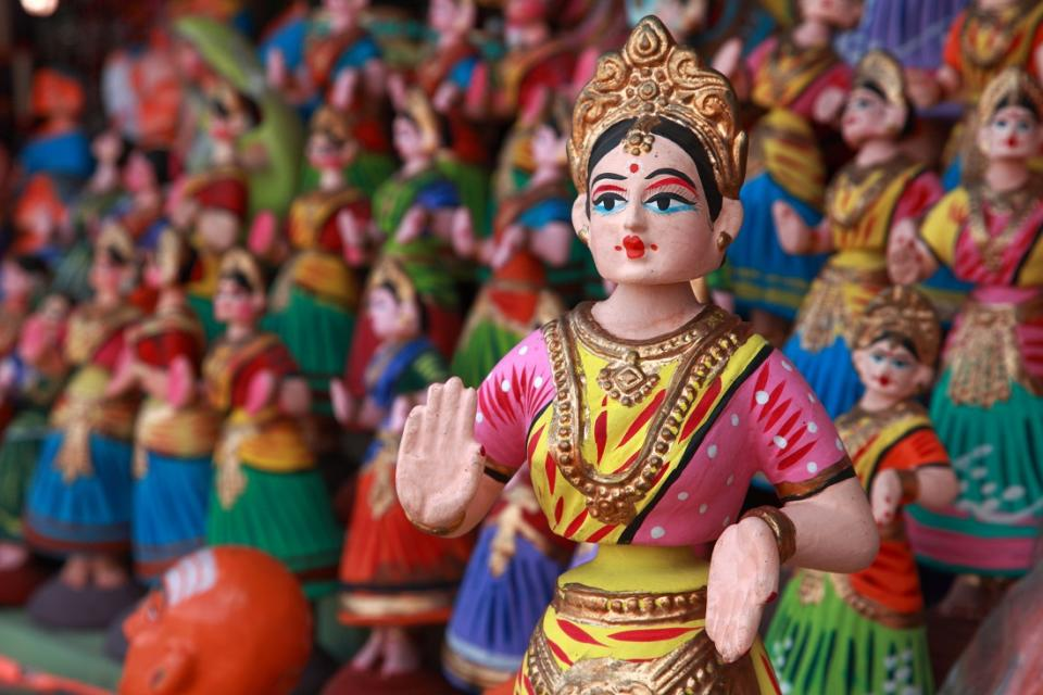 In Tamil language, these dolls are called Thanjavur Thalayatti Bommai which translates to 'Thanjavur Head-shaking Doll'