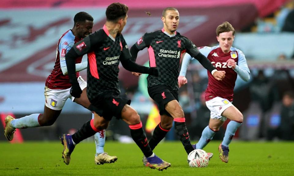 Thiago looks to feed a pass to Roberto Firmino during Liverpool's 4-1 victory over Aston Villa last Friday.