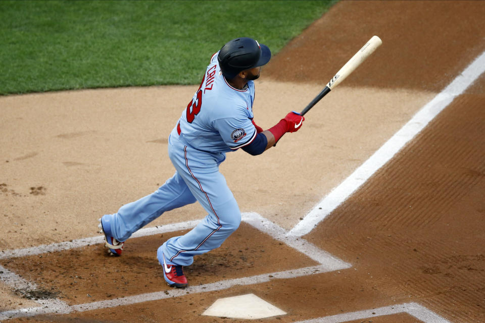 Minnesota Twins' Nelson Cruz hits an RBI double off St. Louis Cardinals pitcher Daniel Ponce de Leon in the first inning of a baseball game Wednesday, July 29, 2020, in Minneapolis. (AP Photo/Jim Mone)