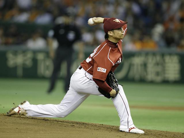 Rakuten Eagles starter Wataru Karashima delivers a pitch against the Yomiuri Giants in the first inning of Game 5 of baseball's Japan Series at Tokyo Dome in Tokyo, Thursday, Oct. 31, 2013. (AP Photo/Toru Takahashi)