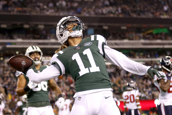 New York Jets wide receiver Robby Anderson (11) launches the football into the stands after catching a touchdown pass from quarterback Sam Darnold (not shown) during the first half of an NFL football game against the Houston Texans, Saturday, Dec. 15, 2018, in East Rutherford, N.J. (AP Photo/Adam Hunger)