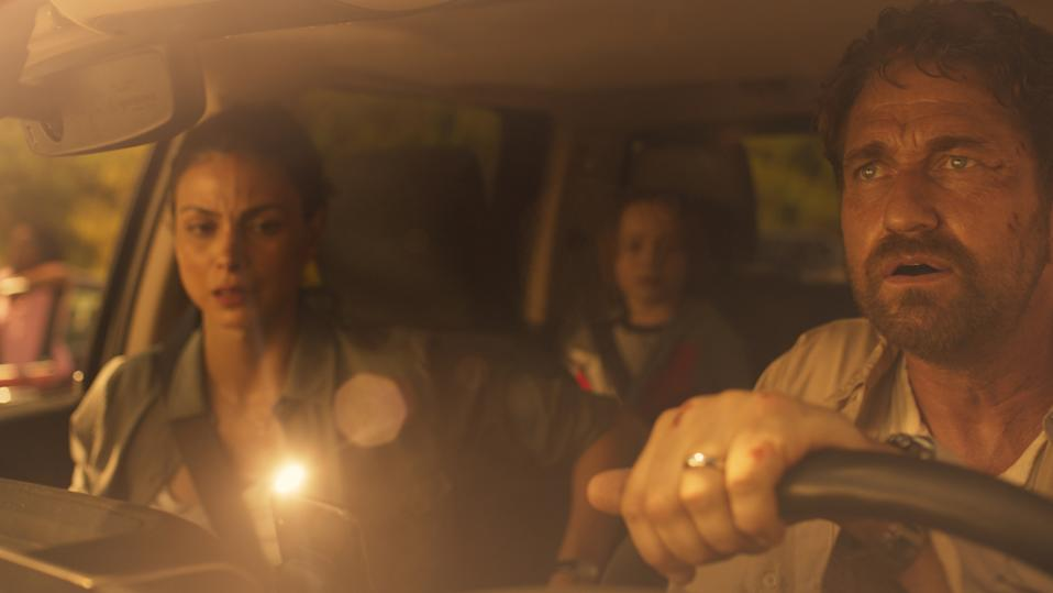 Allison Garrity (Morena Baccarin), John Garrity (Gerard Butler) and Nathan Garrity (Roger Dale Floyd) are horrified to see Geostorm is playing at the drive-in. Photo: Amazon Prime Video.
