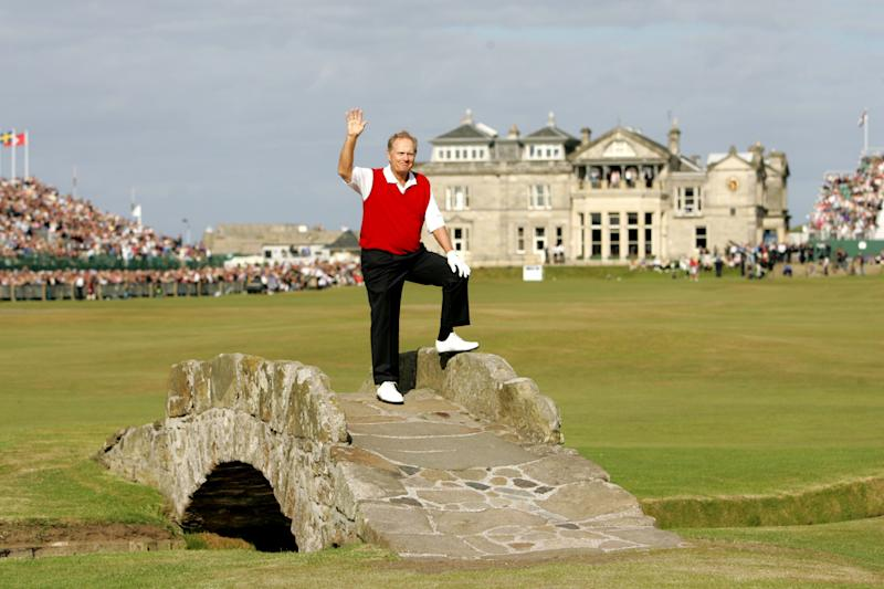 Nicklaus waves from the Swilcan Bridge on the 18th hole at the Old Course as he play his last competitive round at the British Open in 2005.