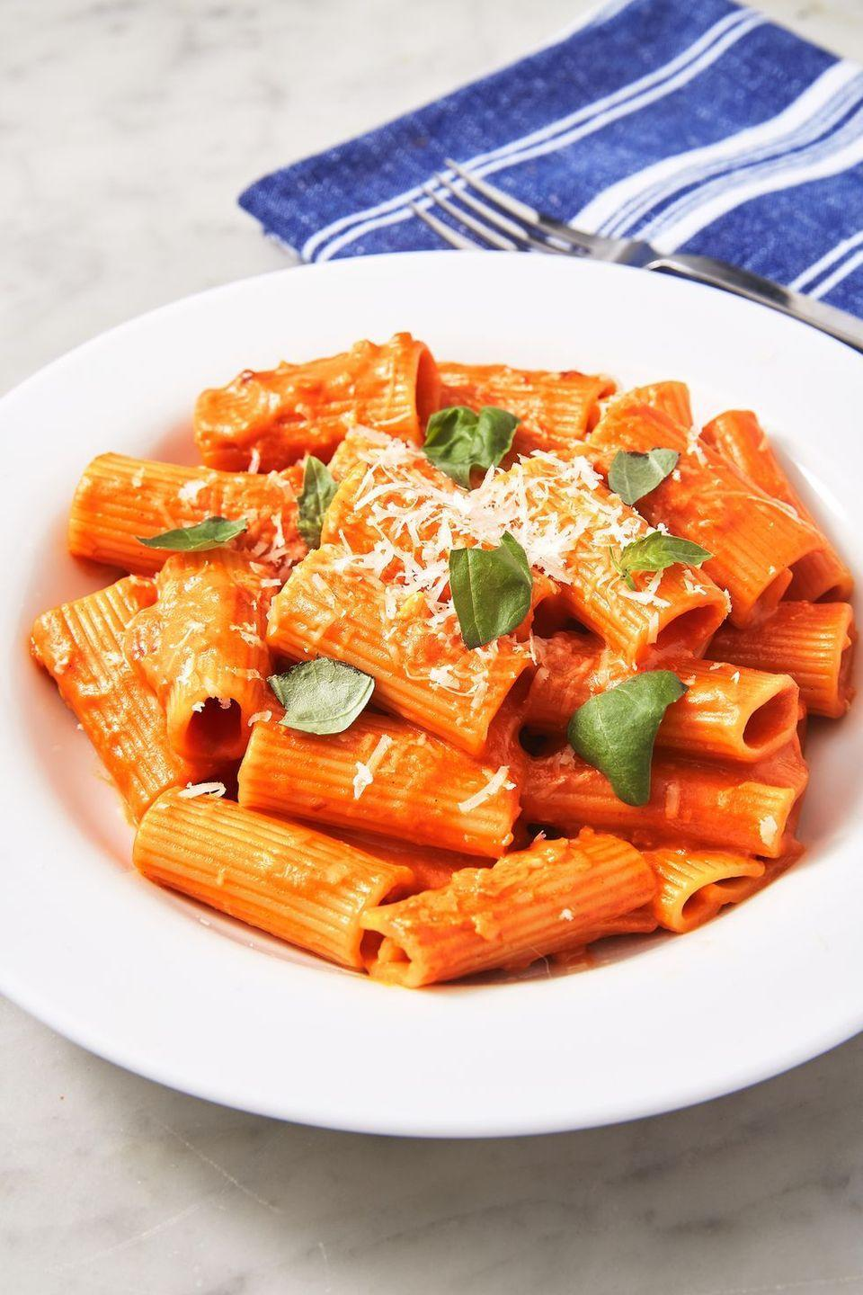 """<p>True story: This is the best vodka sauce any of us in the test kitchen have ever had. It's creamy but bright. The secret: tomato paste.</p><p>Get the <a href=""""https://www.delish.com/uk/cooking/recipes/a30439232/penne-alla-vodka-recipe/"""" rel=""""nofollow noopener"""" target=""""_blank"""" data-ylk=""""slk:Penna Alla Vodka"""" class=""""link rapid-noclick-resp"""">Penna Alla Vodka</a> recipe.</p>"""
