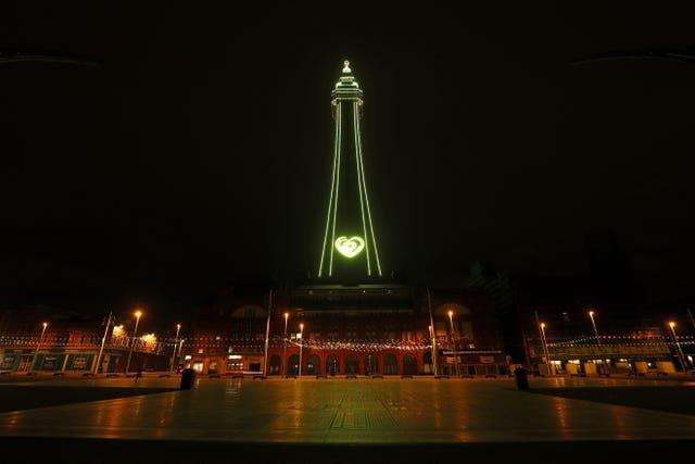 Blackpool Tower is illuminated in yellow to mark the National Day of Reflection