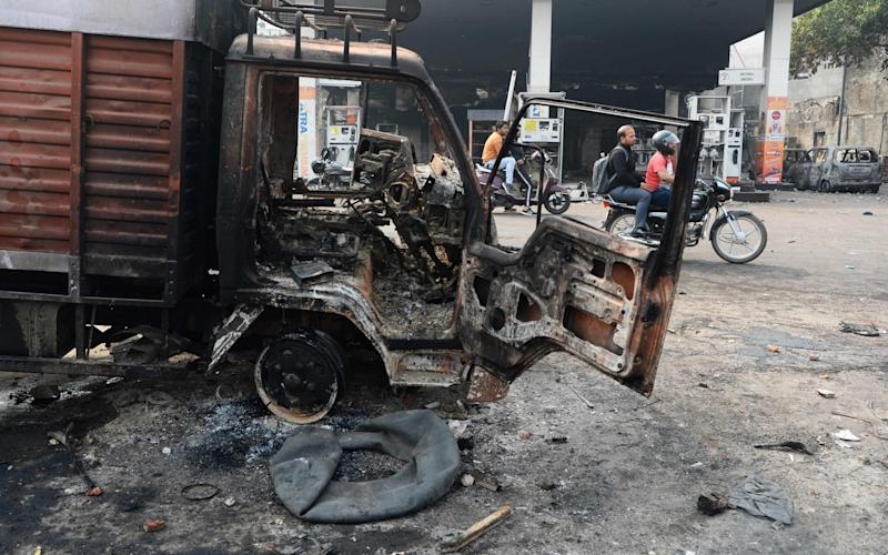 53 died in protests earlier this year in New Delhi following clashes between people supporting and opposing a contentious amendment to India's citizenship law - SAJJAD HUSSAIN/AFP