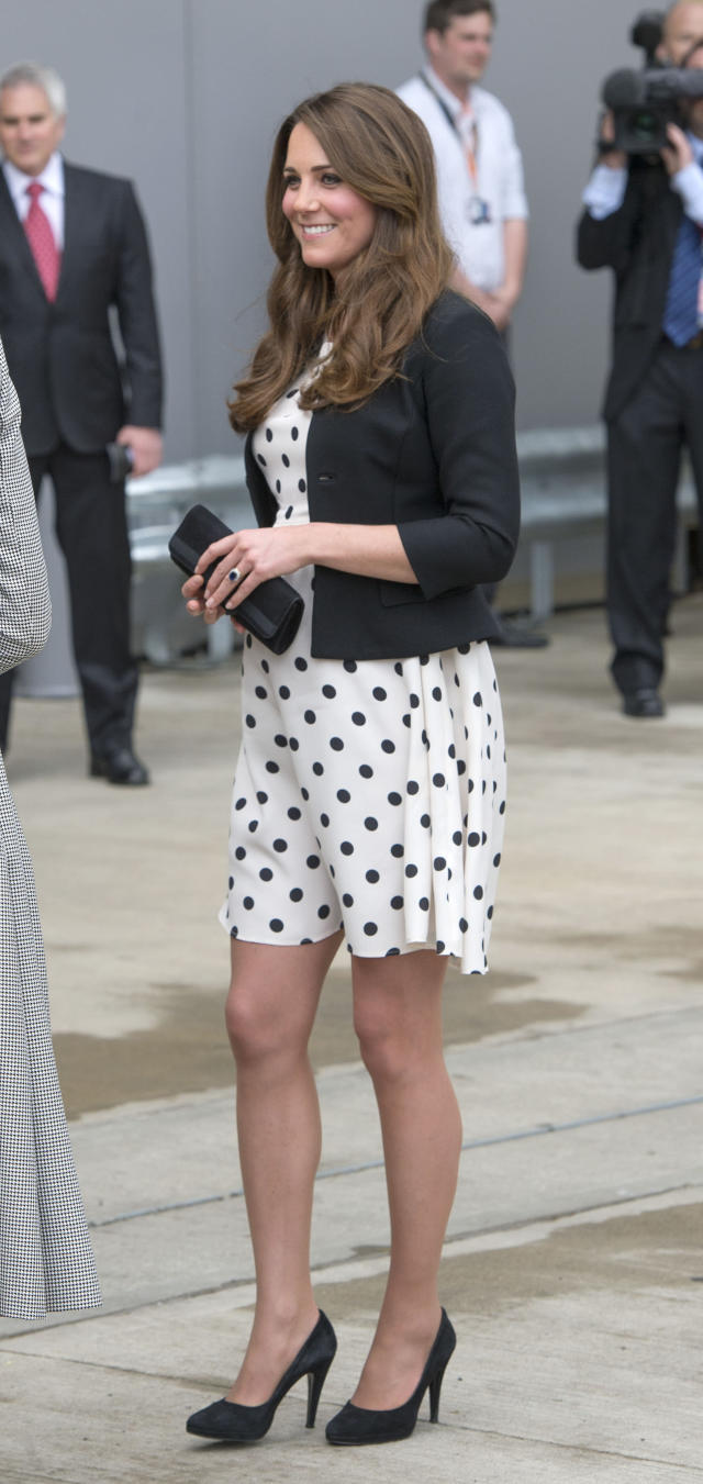 <p>Not one to shy away from a loud print, Kate donned a polka-dot shift dress by Topshop, of all places. (Photo: PA) </p>