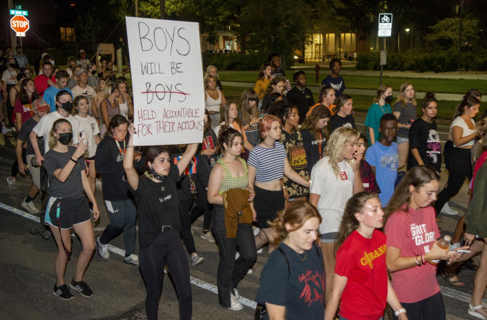 Protesters march around the campus on Wednesday, Aug. 25, 2021, in Lincoln, Neb., in response to the alleged sexual assault at the Phi Gamma Delta fraternity house. Students have protested since Aug. 24 after a student reported being sexually assaulted at the Phi Gamma Delta fraternity house. University of Nebraska-Lincoln Chancellor Ronnie Green temporarily suspended the Fiji house on Aug. 25. (Francis Gardler/Lincoln Journal Star via AP)