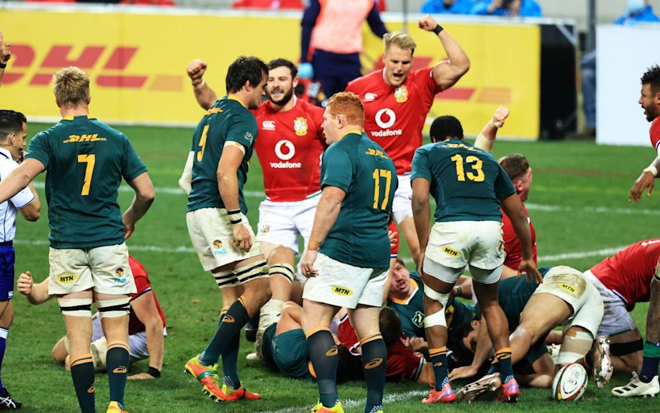 British & Irish Lions players celebrate as Luke Cowan-Dickie of British & Irish Lions stretches over to score their side's first try during the 1st Test between South Africa & British & Irish Lions at Cape Town Stadium on July 24, 2021 in Cape Town, South Africa. - GETTY IMAGES
