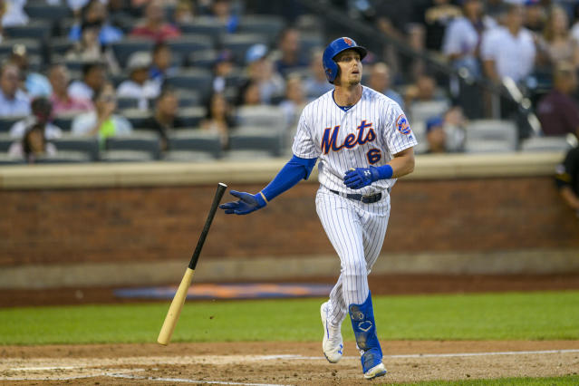New York Mets' Jeff McNeil drops his bat after hitting a three-run home run, also scoring Amed Rosario and Zack Wheeler, during the third inning of a baseball game against the Pittsburgh Pirates, Friday, July 26, 2019, in New York. (AP Photo/Corey Sipkin)