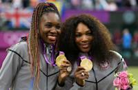 """Gold medalists <a href=""""http://sports.yahoo.com/olympics/tennis/serena-williams-1131104/"""" data-ylk=""""slk:Serena Williams"""" class=""""link rapid-noclick-resp"""">Serena Williams</a> of the United States and <a href=""""http://sports.yahoo.com/olympics/tennis/venus-williams-1131109/"""" data-ylk=""""slk:Venus Williams"""" class=""""link rapid-noclick-resp"""">Venus Williams</a> of the United States celebrate during the medal ceremony for the Women's Doubles Tennis on Day 9 of the London 2012 Olympic Games at the All England Lawn Tennis and Croquet Club on August 5, 2012 in London, England. (Photo by Clive Brunskill/Getty Images)"""
