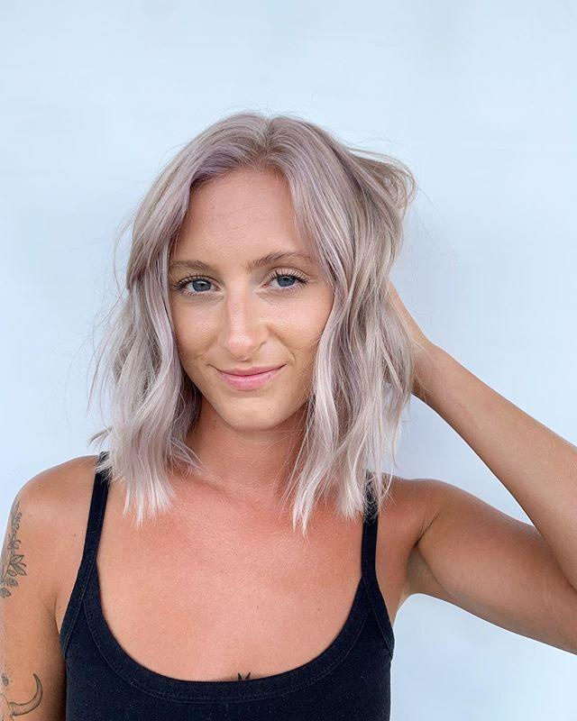 "<p>K, this hair color might look totally <a href=""https://www.cosmopolitan.com/style-beauty/beauty/g30245084/blonde-hair-guide-shades/"" rel=""nofollow noopener"" target=""_blank"" data-ylk=""slk:blonde"" class=""link rapid-noclick-resp"">blonde</a> upon first glance, but look closer and you'll notice <strong>the softest lavender tint</strong>. Pretty, right?</p><p><a href=""https://www.instagram.com/p/CBJiTW0BF49/"" rel=""nofollow noopener"" target=""_blank"" data-ylk=""slk:See the original post on Instagram"" class=""link rapid-noclick-resp"">See the original post on Instagram</a></p>"