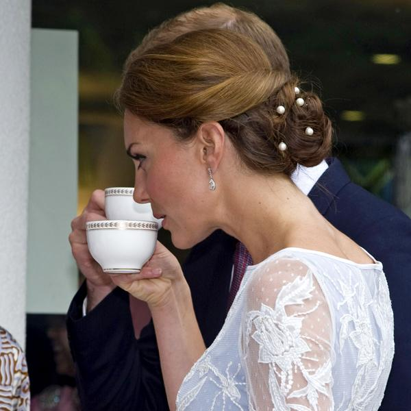 <b>Kate Middleton Top 10 Best Hairstyles:</b> The Duchess of Cambridge showed off a chic, twisted bun style with pearl pins during the couple's tour in Asia in September ©Rex