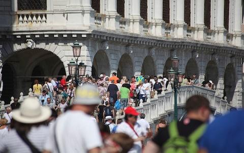 Venice introduced crowd-control measures ahead of the 2018 Easter weekend - Credit: Getty