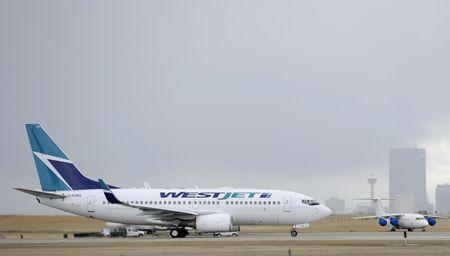 FILE PHOTO: A Westjet Boeing 737-700 takes off at the International Airport in Calgary