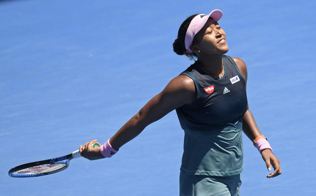 Japan's Naomi Osaka celebrates after defeating Latvia's Anastasija Sevastova during their fourth round match at the Australian Open tennis championships in Melbourne, Australia, Monday, Jan. 21, 2019. (AP Photo/Andy Brownbill)