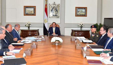Egyptian President Abdel Fattah al-Sisi (C) meets with his prime Minister Sherif Ismail (4th L) with other ministers and senior State officials at the Ittihadiya presidential palace in Cairo, Egypt March 13, 2017 in this handout picture courtesy of the Egyptian Presidency. The Egyptian Presidency/Handout via REUTERS