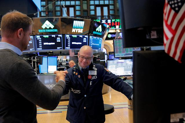 Traders fist bump following the market close on the floor at the New York Stock Exchange (NYSE) in Manhattan, New York City, U.S., February 9, 2018. REUTERS/Andrew Kelly