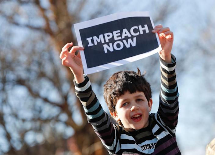 """<p>Marcel Ast, 10, from New Jersey, holds up a sign during a """"Not My President's Day"""" rally at DuPont Circle in Washington, Monday, Feb. 20, 2017. Anti-President Trump activists seized on Monday's federal holiday to organize rallies in cities around the country to oppose policies by Trump. (AP Photo/Pablo Martinez Monsivais) </p>"""