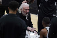 San Antonio Spurs head coach Gregg Popovich talks to his players during a timeout in the second half of an NBA basketball game against the Milwaukee Bucks in San Antonio, Monday, May 10, 2021. (AP Photo/Eric Gay)