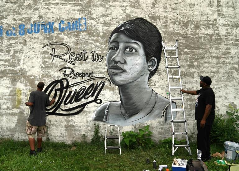 "A man paints a mural of the ""Queen of Soul"" Aretha Franklin near New Bethel Baptist - her father's church - in Detroit, Michigan"