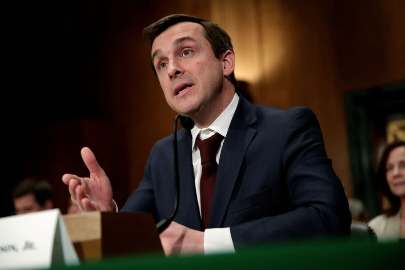 FILE PHOTO: Robert Jackson Jr. testifies to the Senate Banking, Housing and Urban Affairs Committee on his nomination to be a member of the SEC in Washington
