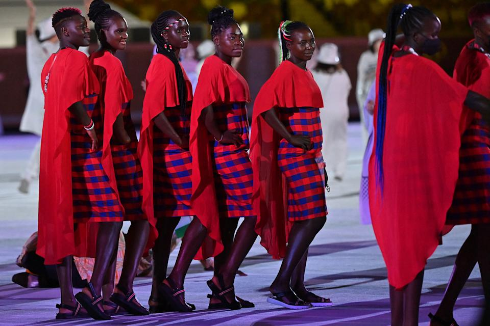 <p>Members of Kenya's delegation parade during the opening ceremony of the Tokyo 2020 Olympic Games. (Photo by Andrej ISAKOVIC / AFP) (Photo by ANDREJ ISAKOVIC/AFP via Getty Images)</p>