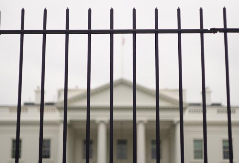 The White House is seen behind a fence on October 3, 2014 in Washington, DC (AFP Photo/Mandel Ngan)