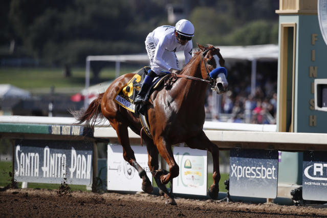 Justify, ridden by Mike Smith, crosses the finish line to win the Santa Anita Derby horse race at Santa Anita Park, Saturday, April 7, 2018, in Arcadia, Calif. (AP)