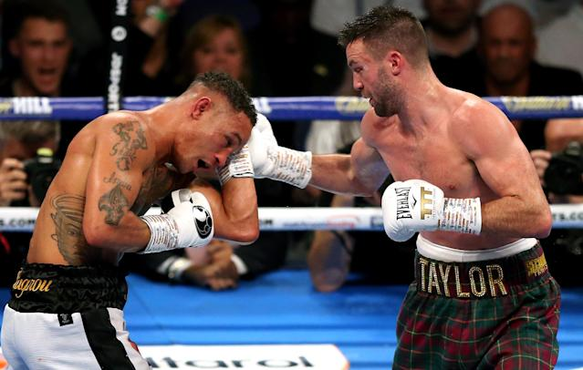 Josh Taylor (R) and Regis Prograis during the super-lightweight unification at the O2 Arena, London. (Getty Images)