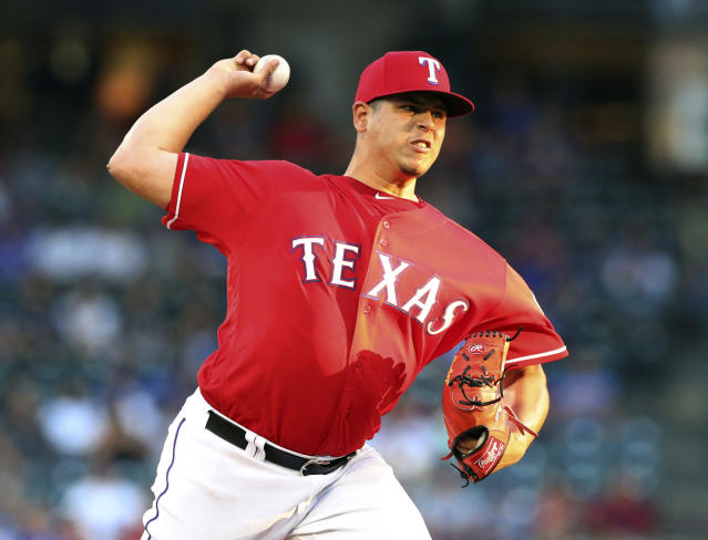 Texas Rangers starting pitcher Ariel Jurado (57) delivers a pitch against the Los Angeles Dodgers in the first inning of a baseball game Tuesday, Aug. 28, 2018, in Arlington, Texas. (AP Photo/Richard W. Rodriguez)