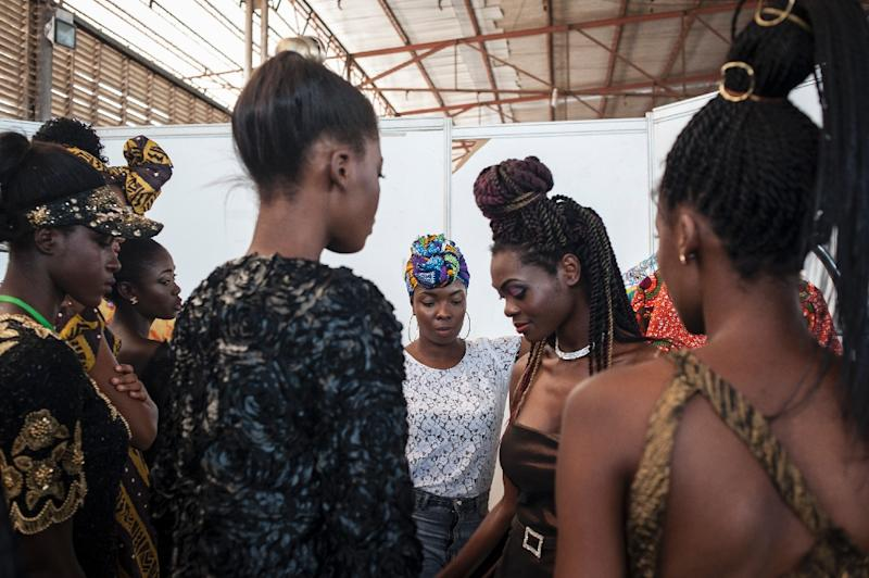 While organiser Nana Tamakloe wanted the Accra Fashion week to highlight locally designed clothing, he said that empowering women through fashion was a bonus (AFP Photo/Stefan Heunis)