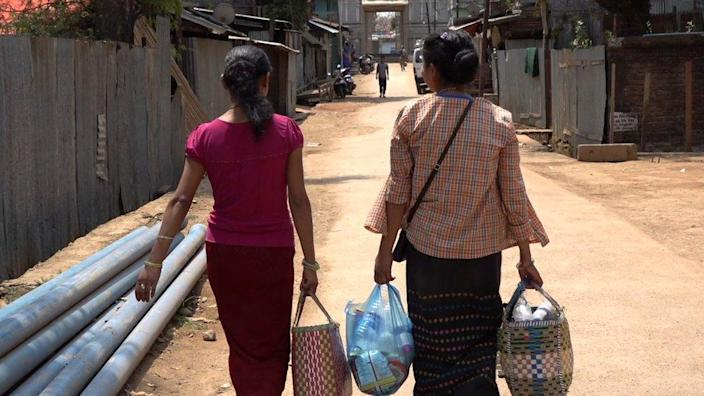 Women who sell milk from Tam in Myanmar to More in India every day.