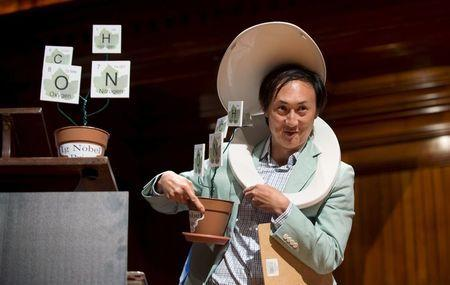 Wearing a toilet seat on his head, David Hu, Associate Professor of Mechanical Engineering and Biology at Georgia Institute of Technology, walks away with his team's Ig Nobel Prize in Physics for testing the biological principle that nearly all mammals empty their bladders in about 21 seconds (plus or minus 13 seconds) at the 25th First Annual Ig Nobel Prizes awards ceremony at Harvard University in Cambridge, Massachusetts September 17, 2015. REUTERS/Gretchen Ertl