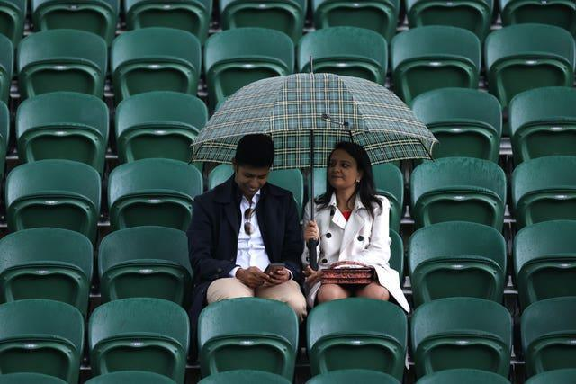 Spectators at Wimbledon also had to contend with the British summer weather