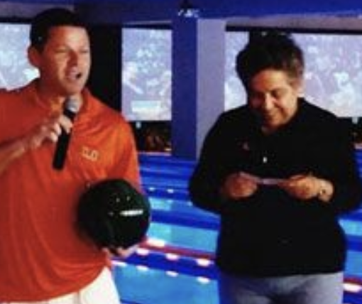 Nevin Shapiro said this photo was taken during a basketball fundraiser in 2008, in which the booster donated $50,000 to the program. On the right is University of Miami president Donna Shalala, holding Shapiro's donation check. (Yahoo Sports)
