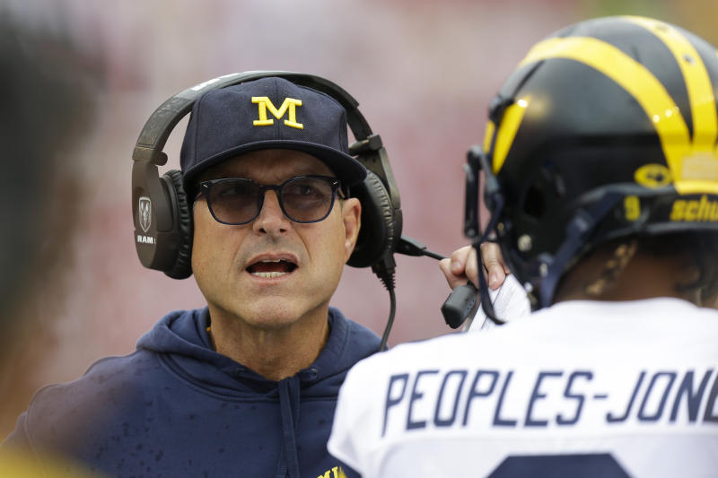 Michigan head coach Jim Harbaugh talks with wide receiver Donovan Peoples-Jones during the first half of an NCAA college football game against Wisconsin Saturday, Sept. 21, 2019, in Madison, Wis. Wisconsin won 34-14. (AP Photo/Andy Manis)