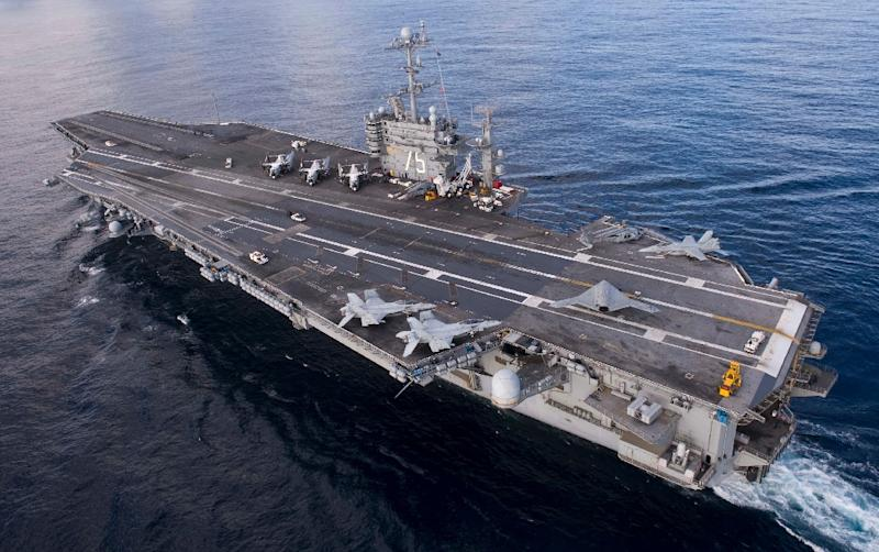 US military officials said last week that the Iranian Navy had test fired several rockets near the aircraft carrier USS Harry S Truman in the Strait of Hormuz (AFP Photo/Kristina Young)
