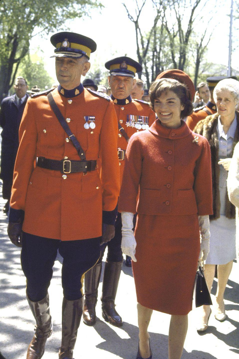 "<p>During her time as First Lady, Jackie and her <a href=""https://www.townandcountrymag.com/style/fashion-trends/g9947418/10-brands-jackie-kennedy-loved/?slide=1"" rel=""nofollow noopener"" target=""_blank"" data-ylk=""slk:signature skirt suits"" class=""link rapid-noclick-resp"">signature skirt suits</a> by designer Oleg Cassini became iconic. </p><p><strong>More: </strong><a href=""https://www.townandcountrymag.com/style/fashion-trends/g9947418/10-brands-jackie-kennedy-loved/"" rel=""nofollow noopener"" target=""_blank"" data-ylk=""slk:10 Brands Jackie Kennedy Loved"" class=""link rapid-noclick-resp"">10 Brands Jackie Kennedy Loved </a></p>"