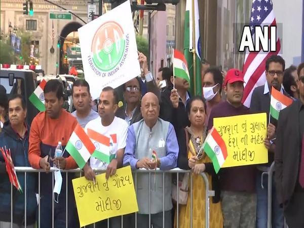 Members of the Indian diaspora gathered outside the hotel in New York on Saturday.